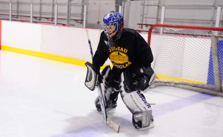 Aspiring goalie Colton Johns gets ready to stop an on-coming puck during JDIA's skills development camp that attracted nine goalies.