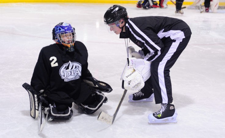 Goaltender coach Heather Strickland works with Anna Dale during JDIA's skills development camp that attracted nine goalies.