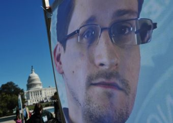 An image of Edward Snowden on the back of a banner is seen infront of the U.S. Capitol during a protest against government surveillance on October 26, 2013 in Washington, D.C. Mandel Ngan /AFP/Getty Images