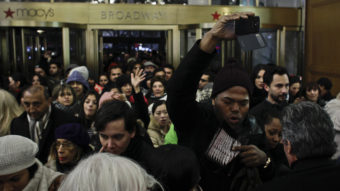 People enter Macy's Herald Square store after opening its doors at 8 p.m. on Thanksgiving Day in New York City. Kena Betancur/Getty Images