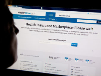 A woman looks at the HealthCare.gov insurance exchange internet site October 1, 2013. Karen Bleier/AFP/Getty Images