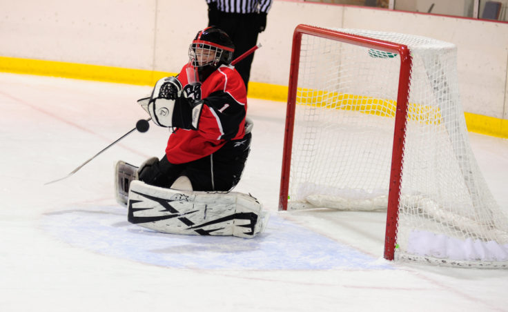 Juneau goalie Liam McDermott stops one of 24 Soldotna shots in Saturday's game at Treadwell Ice Arena.