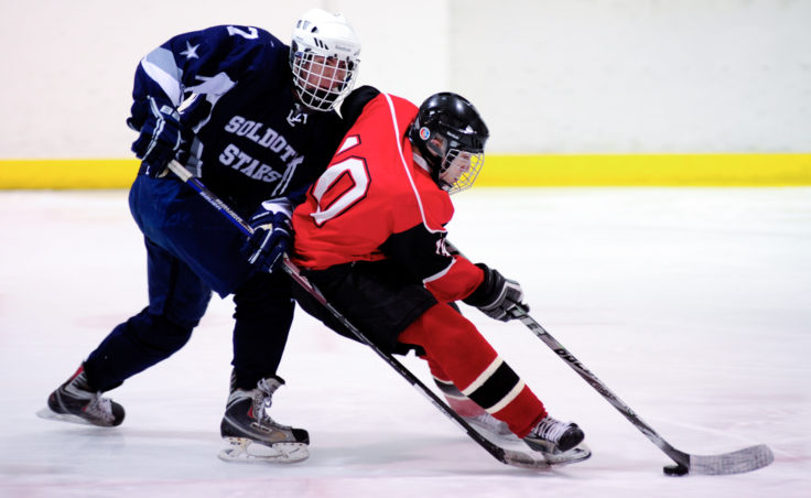 Juneau center Ethan Seid stays just ahead of Soldotna's Justin Miller on a break to the net during the team's season opening series versus Soldotna at Treadwell Ice Arena.