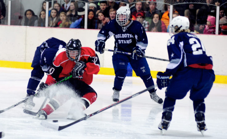 Juneau center Ethan Seid kicks up some ice while finding himself in a crowd of Soldotna players during the weekend series at Treadwell Ice Arena.