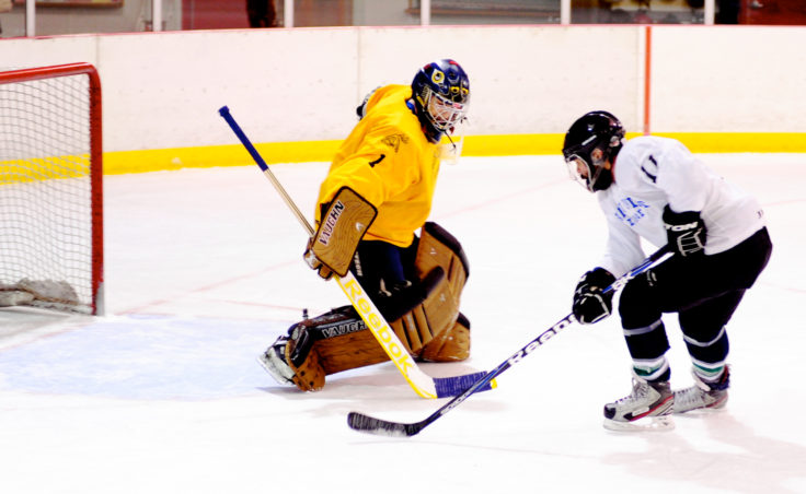 Some games came down to a shootout overtime. In this case, Lemon Creek goaltender Jason Soza keeps Taku's Jeff Nichols from scoring in a game that Lemon Creek prevailed.