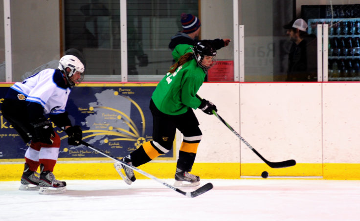 Alaska Airlines Pat Malecha chases down Winnipeg's Mindy Shaw during a B Tier title game won by Alaska Airlines, 1-0.