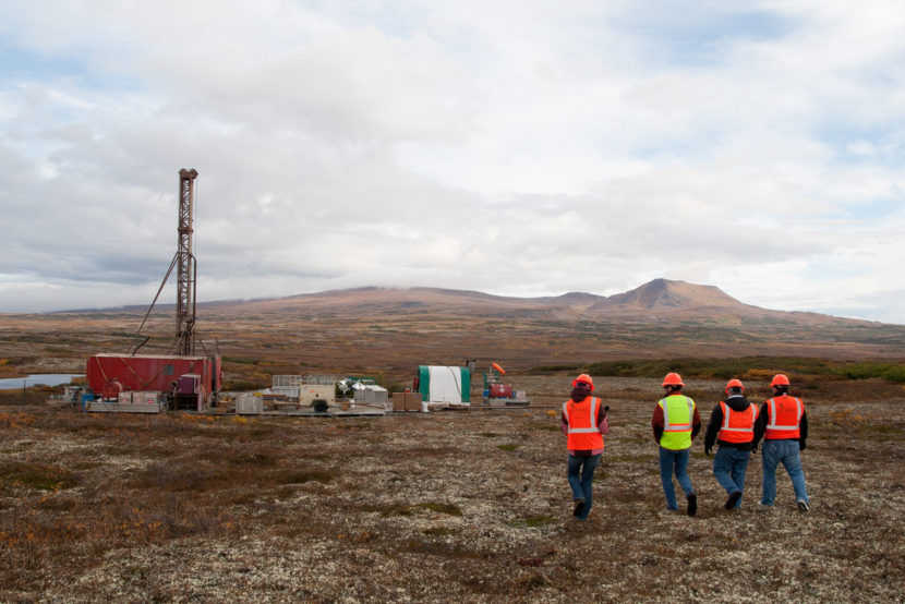 Members of the media walking to an exploratory drill rig. Photo by Jason Sear, KDLG – Dillingham