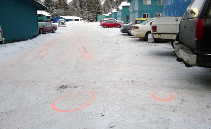Investigators mapped out possible vehicle paths related to a shooting Friday at the south end of the Coho Park Apartments. (Photo by Jeremy Hsieh/KTOO)