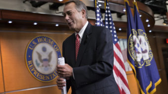 """House Speaker John Boehner leaves a news conference Thursday, after criticizing conservative groups that he said held too much sway in Republican politics, """"pushing our members in places where they don't want to be."""" J. Scott Applewhite/AP"""