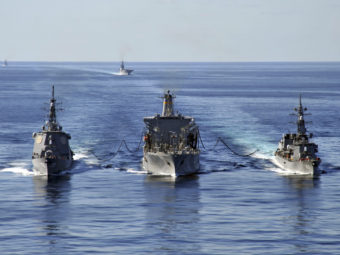 In this Dec. 5, 2010 file photo released by U.S. Navy, USNS Tippecanoe, center, refuels Japan Maritime Self-Defense Force Escort Flotilla ships Ikazuchi, right, and Kongo during a joint military exercise in the Pacific Ocean. Charles Oki/AP