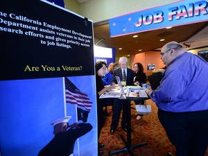A prospective job seeker gets information at a job resource fair for military veterans in Van Nuys, Calif., on Oct. 24. Frederic J. Brown/AFP/Getty Images