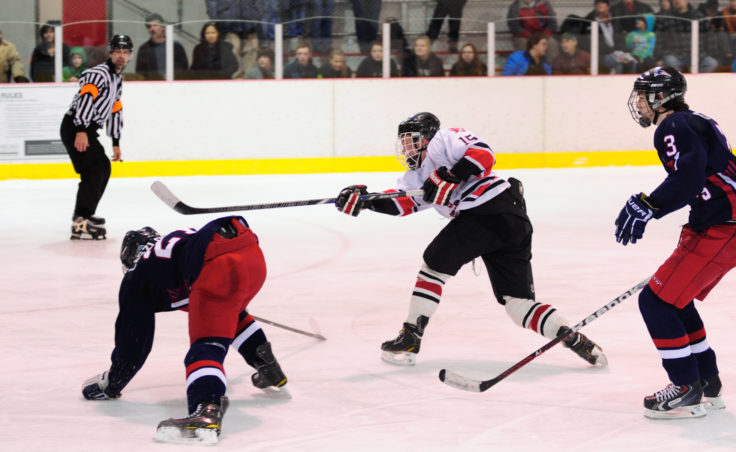After evading two North Pole defenders, Juneau left winger/defenseman Cole Cheeseman gets a shot off during the two-game series at Treadwell Ice Arena.