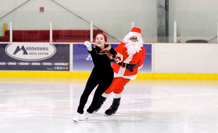 Laurie Balstad brings Santa on to the ice for a final series of dances and curtain call to include Mrs. Claus and all of Sunday's performers at Treadwell Ice Arena.