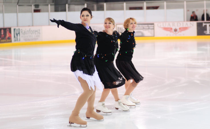 (From left) Skating instructors Maggie Frank, Sigrid Dahlberg and Wendy Vuille link up during an opening number featuring all performers dancing to Jingle Bell Rock.