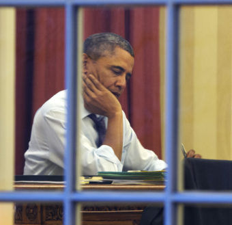 President Obama, working at his desk Monday night on the eve of his 2014 State of the Union address. Jacquelyn Martin/AP