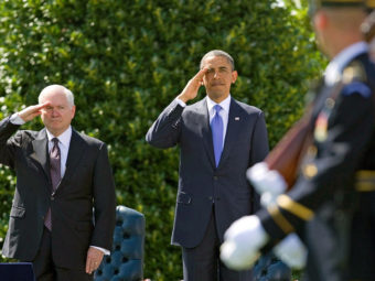 Defense Secretary Robert Gates and President Obama salute during a farewell ceremony for Gates on June 30, 2011. Evan Vucci/AP
