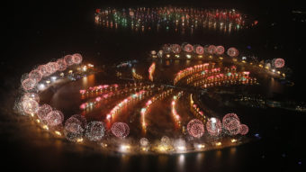Fireworks explode over Palm Jumeirah in Dubai on Jan. 1, 2014, to celebrate the new year. Dubai's glittering fireworks display that lasted around six minutes spanned over 100 kilometres (60 miles) of the Dubai coast, which boasts an archipelago of man-made islands. Karim Sahib/AFP/Getty Images