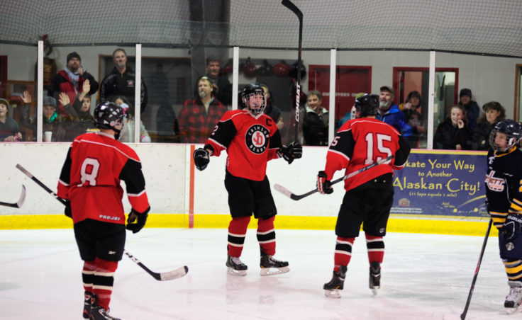 Juneau Captain Grant Ainsworth celebrates a goal during the second of two games against Bartlett High at Treadwell Ice Arena.