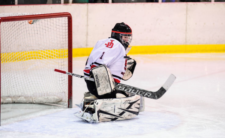 Juneau goaltender Liam McDermott deflects a shot to his right en route to a shut out versus Monroe Catholic.