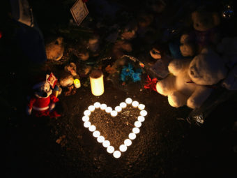 Newtown, Conn., Dec. 20, 2012: Stuffed animals and a candle arrangement at a streetside memorial for the 20 children and six adults killed at Sandy Hook Elementary School. John Moore/Getty Images