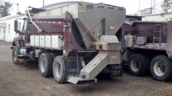 A salt truck is outfitted with side tanks that spray liquid cheese brine on the roads of Polk County, Wisconsin. Highway officials say the approach is more effective than using salt alone and reduces waste. Emily Norby/Polk County Highway Dept.