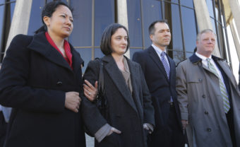 Couples Cleopatra De Leon and Nicole Dimetman and Victor Holmes and Mark Phariss speak with reporters outside the U.S. Federal Courthouse in San Antonio earlier this month. The judge in their case ruled Texas' ban on gay marriage unconstitutional Wednesday. Eric Gay/AP