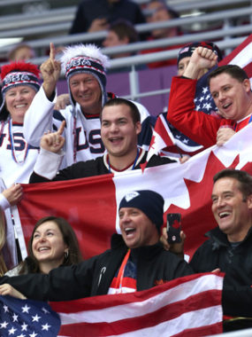 U.S. and Canadian fans attend the women's hockey gold medal game in Sochi Thursday. A recent Gallup poll finds that Americans see Canada in the most favorable light, compared to other countries. (Bruce Bennett/Getty Images)