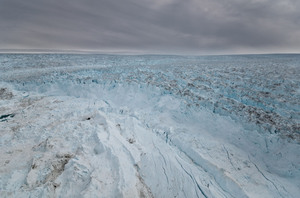 Massive sections of ice (center front) have broken away from the Jakobshavn glacier into the sea. There's enough water stored in Greenland's glaciers to raise the sea level by 20 feet. Ian Joughin/Science/AAAS