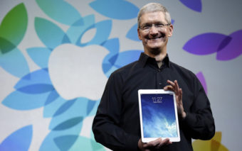 Apple CEO Tim Cook introduced the iPad Air in October 2013. The company says it is publicizing the names of suppliers that are still sourcing minerals from conflict regions. Marcio Jose Sanchez/AP
