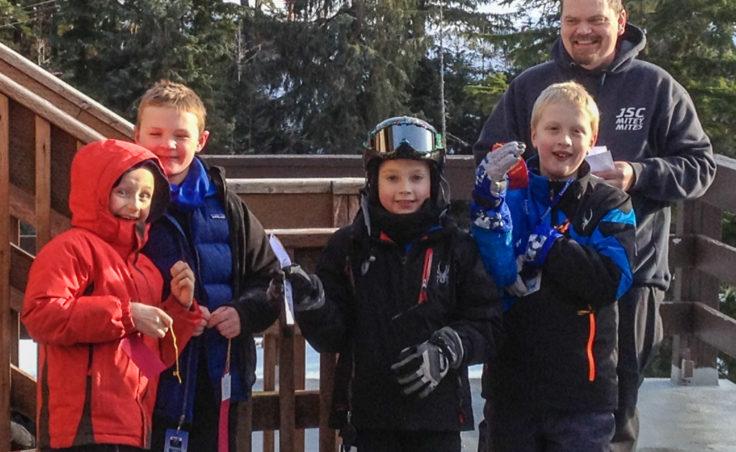 The Falcons ski group with coach Mike Satre. (L-R) Malachi Peimann, age 8; Sage Richards, 8; Karter Kohlhase, 8; and Adrian Whitney, 9. (Photo courtesy Dana Richards)