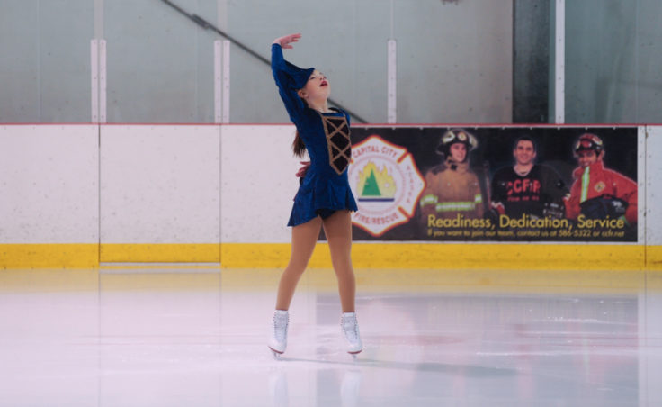 Kara Hort punctuates her performance by striking this final pose during her routine at Treadwell Ice Arena.