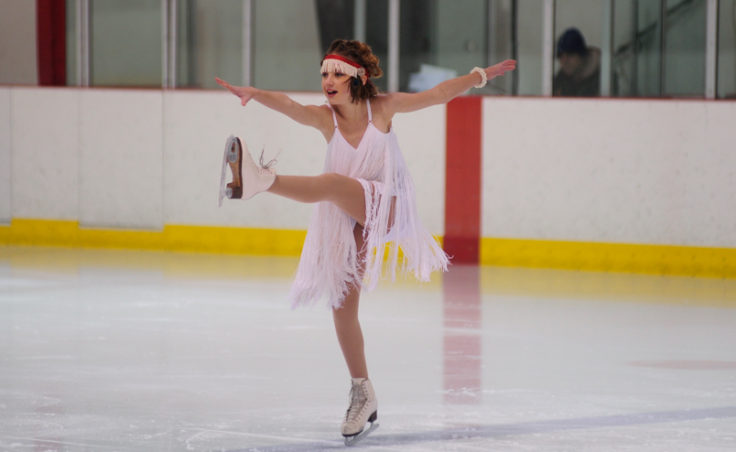 Grace Walli does a kick while balancing on the skate's jagged toe pick during her performance.