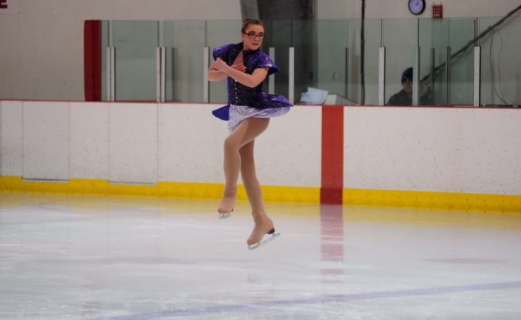 Emily Bowman gets air time during her routine at Treadwell Ice Arena Sunday.