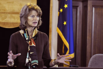 Sen. Lisa Murkowski talks with reporters during a press availability following her annual address to the legislature, Feb. 19 2014. (Photo by Skip Gray/Gavel Alaska)