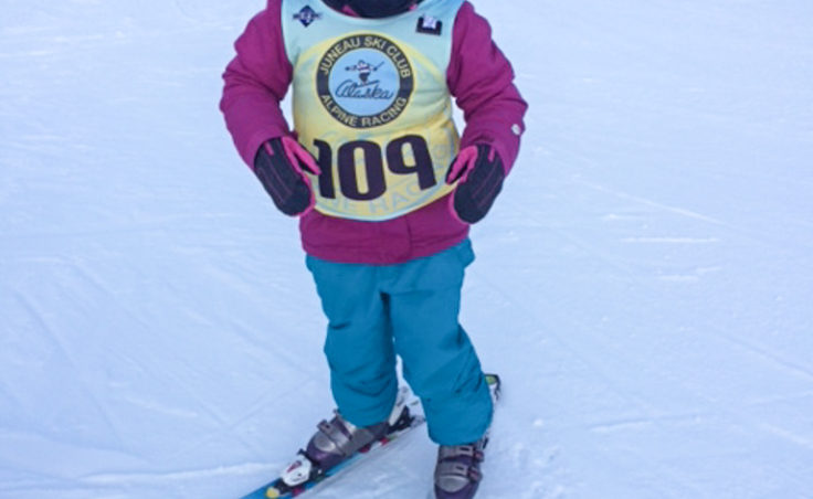 Paige Adams poses for the camera at the start of the Mighty Mite race. Paige came in first for the Eagles group.