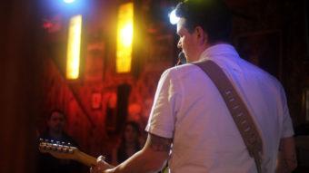 Morgan Deering playing guitar at the Alaskan