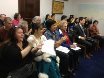 The Barnes Committee Room erupts in applause after an Alaska House committee advanced legislation that would make 20 Alaska Native languages official state languages on Feb. 18, 2014.