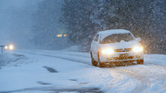 This car was navigating a snowy road early Tuesday in Fort Payne, Ala. The wicked winter weather there is spreading across the Deep South. Hal Yeager/AP
