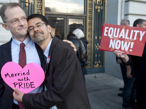 John Lewis (left) and Stuart Gaffney embrace outside San Francisco's City Hall shortly before the U.S. Supreme Court ruling cleared the way for same-sex marriage in California in June. Noah Berger/AP
