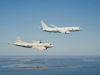 A P-8A Poseidon (top) and a P-3 Orion are shown flying off the coast of Maryland. U.S. Navy
