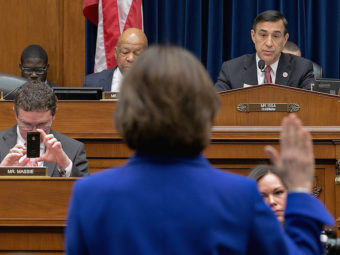 Former IRS official Lois Lerner raises her hand as she's sworn in Wednesday at the start of a House Oversight & Government Reform Committee hearing. She declined to answer questions posed by Chairman Darrell Issa, invoking her Fifth Amendment right. Chip Somodevilla/Getty Images