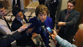 Sen. Dianne Feinstein speaks to reporters after speaking about her oversight committee's problematic relationship with the CIA Tuesday. CIA Director John Brennan says his agency isn't trying to delay the panel's report on the U.S. interrogation program. Mark Wilson/Getty Images