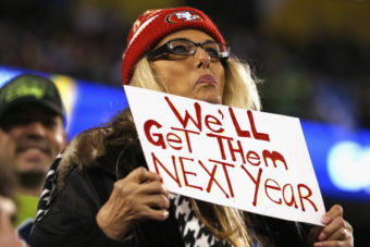 A 49ers fan displays her hopes for next season at a Seahawks game. If a San Francisco fan has his way, the sign could also refer to playoff tickets, which were limited to markets with strong Seattle support this year. Kevin C. Cox/Getty Images