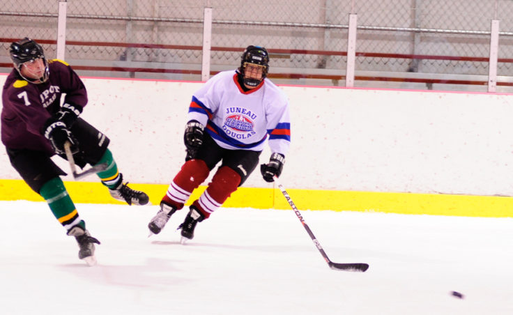 Dupont's Mark Kaelke (left) clear's the puck away from A-Bombs' Karen Blejwas.