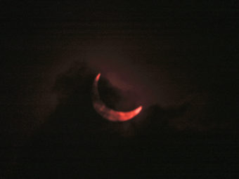 A cloud layer partially obstructs a view of a the moon passing in front of the sun in this partial solar eclipse, on Nov. 3, 2013 in Nairobi, Kenya. Sayyid Azim/AP
