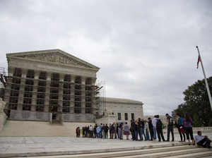 People wait in line for the beginning of the Supreme Court 2013-2014 opening term in Washington, on Oct. 7, 2013. They heard the first major case on campaign contribution limits since the landmark 2010 Citizens United. Evan Vucci/AP