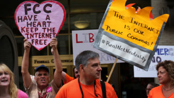 """Demonstrators protest outside the Federal Communications Commission Thursday. The agency voted to open new proposed rules for public comment, including a discussion of whether """"paid prioritization"""" should be banned. Alex Wong/Getty Images"""