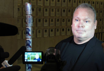 Chaz Stevens talks with reporters after setting up his Festivus pole made out of beer cans at the Florida Capitol building in Tallahassee, Fla., in December of 2013. Brendan Farrington/AP