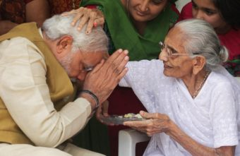 India's next prime minister, Narendra Modi, receives a blessing from his mother at her home in the western state of Gujarat on Friday, as election results showed a resounding win for Modi's opposition party. Ajit Solanki/AP