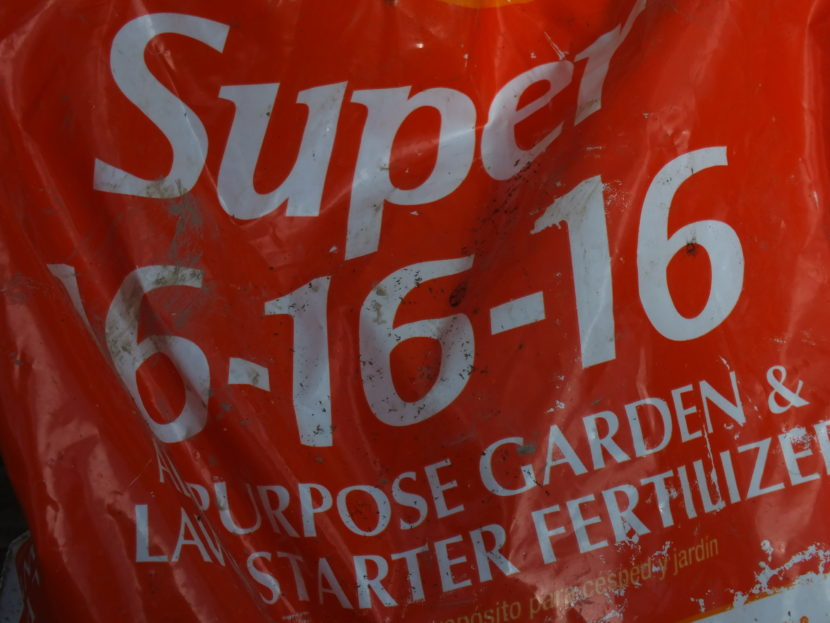 Front of bag of 16-16-16 fertilizer specifies proportions of nitrogen, phosphate, and potash.